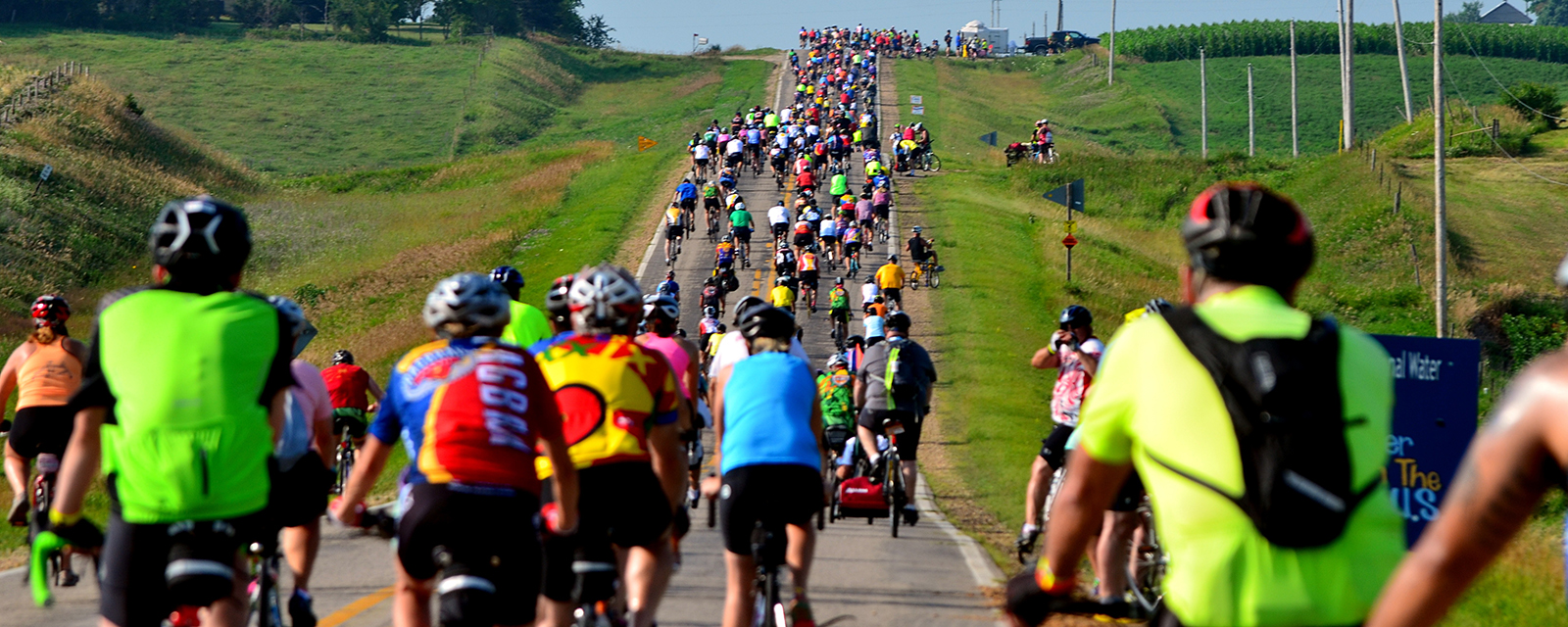 Cyclists climb uphill during a non-competitive bicycle ride in Iowa