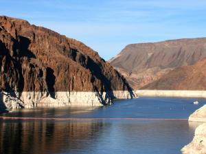 "Low water at Lake Mead exposes a wide ""bathtub ring"" that marks the lake's former level."