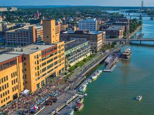 Green Bay's CityDeck with the Peacemaker tall ship docked at the Cherry Street boat landing.