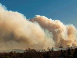 Photo of plume of smoke is seen rising from the North Fork fire in Jefferson County, Colorado
