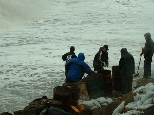Photo of young men trying to mitigate erosion near Kivalina, Alaska