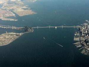 Aerial view of the San Francisco Bay with the Bay Bridge in foreground.