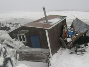 Ice damage to a camp near Golovin, Alaska
