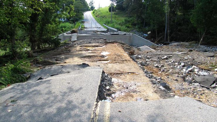 Photo of roadway washed out by flood