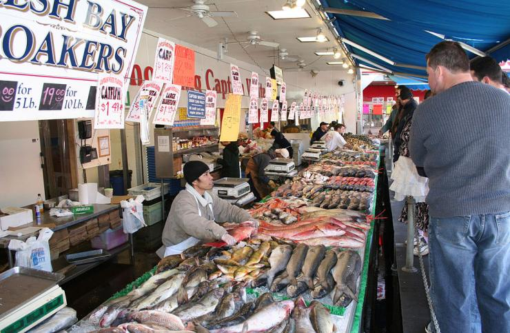 People shopping and selling fresh fish