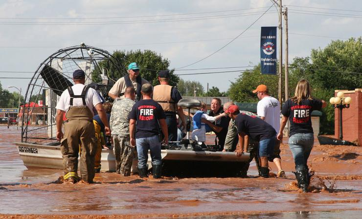 First responders gather flood victims on airboat
