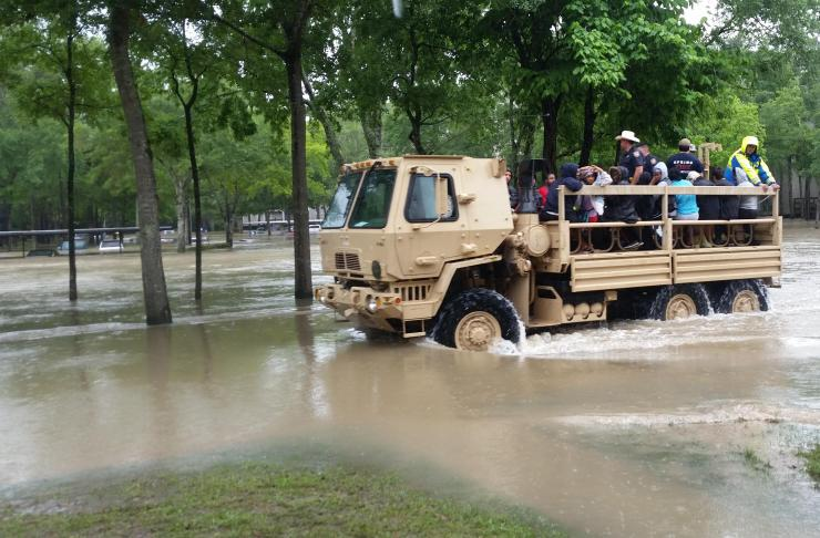 Photo of Texas Guardsmen in a truck after severe flooding in Houston