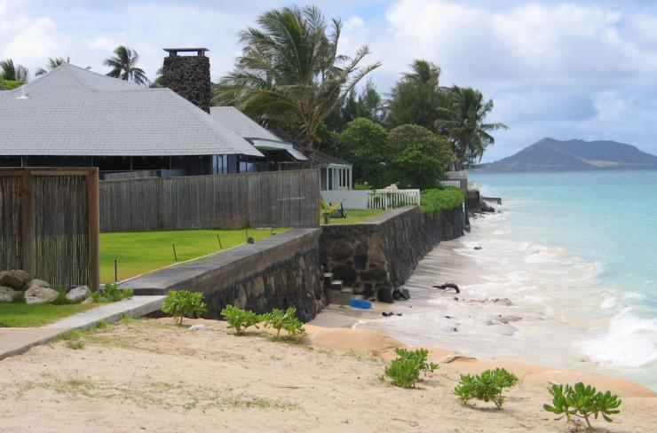 Coastal homes with rock seawalls and very little beach sand