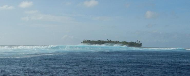 Ocean wave with island