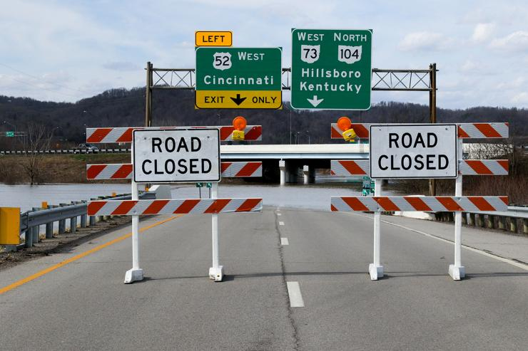 Road closure signs due to submerged roadways in Ohio