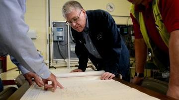 Chris Wiesmann and staff plan flood mitigation efforts.