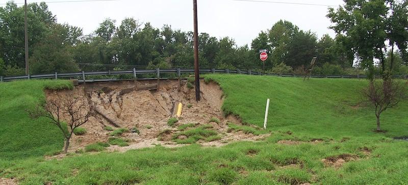 Photo of erosion at edge of raised road