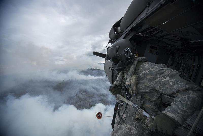 Photo of Alaska Army National Guardsman fighting a wildfire in Alaska