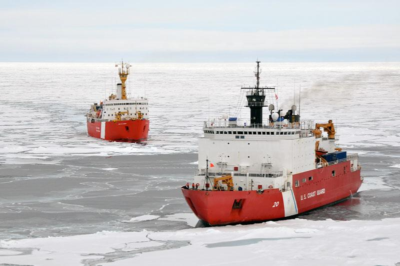 Two icebreaker ships with open water and floating ice