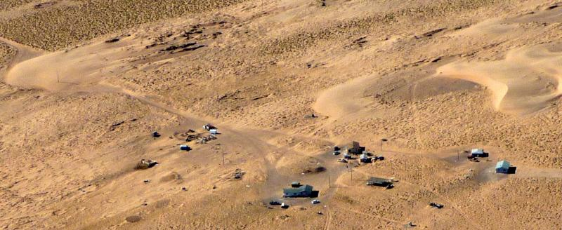 Aerial view of sand dunes threatening to engulf homes