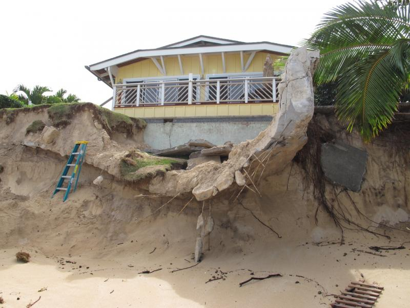 Confronting shoreline erosion on oahu us climate resilience toolkit eroding cliff below a former beachfront house thecheapjerseys Image collections