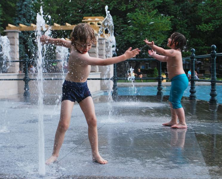 Photo of children playing in a fountain