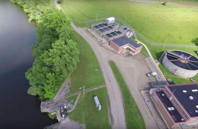 Aerial view of river and water treatment plant