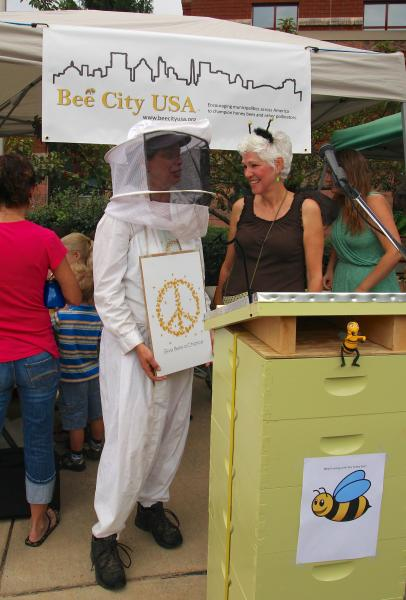 Pollinator advocate Phyllis Stiles (right) promotes Bee City USA