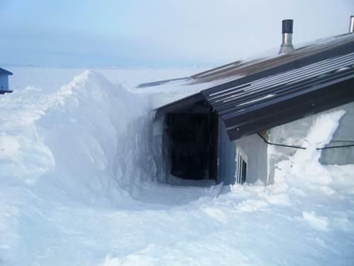 Photo of the effects of a 2009 three-day snowstorm in Kivalina, Alaska