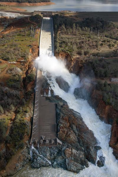 Water flowing down and out of damaged spillway