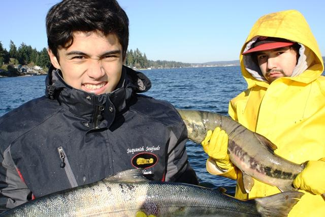 Chief Kitsap Academy students with a catch of chum salmon