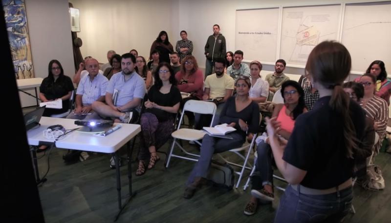 People in a workshop watching a slide presentation