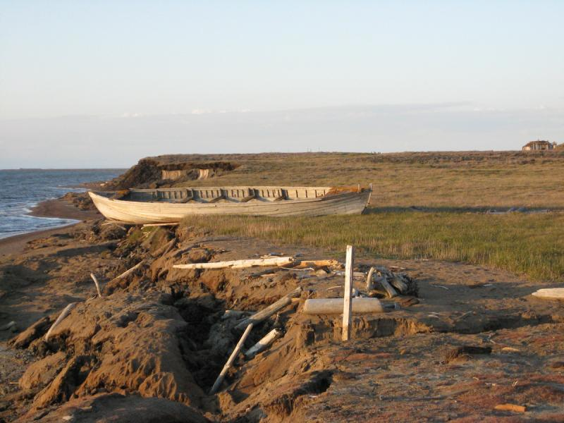 Photo of historic whaling boat on an eroding bluff