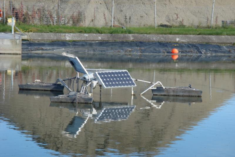 Solar panels mounted above wastewater pool