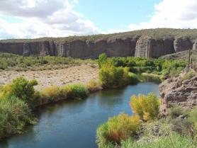 River flowing through desert landscape